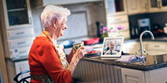 A son having a video chat with his elderly mother