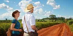 A Christian couple ready to go down a long dirt road to preach