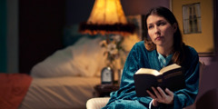 Late at night, a sister reads the Bible and meditates