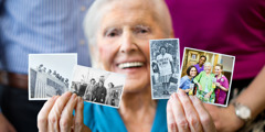 An older sister holds up photos of herself sharing in various features of the ministry