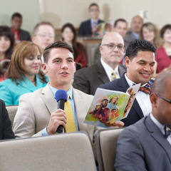 A young man comments at a congregation meeting