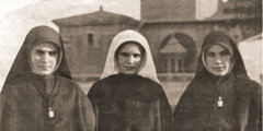 Three of the Fernández sisters, two wearing Catholic nun habits and one wearing the white veil of a novitiate