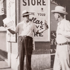Thomas McLain's father offers magazines on a street corner