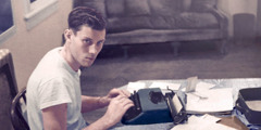 William Samuelson as a young man using a manual typewriter