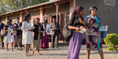 Jehovah's Witnesses in Zambia leave the Kingdom Hall to go in field service