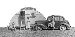 Arthur and Olive Matthews beside their car and camper trailer