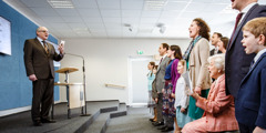 Young and old alike sing at a congregation meeting