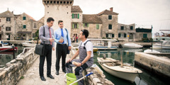 Two brothers offer a tract to a man near Split, Croatia