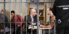 Reenactment of a Bible study being conducted in a Bulgarian prison with an interested inmate