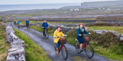 Jehovah's Witnesses ride bicycles on the Aran Islands, off the coast of Ireland, to share the good news with people there
