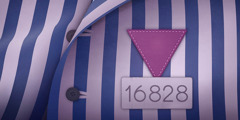 A striped uniform with a purple triangle and a prisoner's number, used to identify Jehovah's Witnesses in Nazi concentration camps.