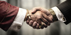 A clergyman and a businessman, each wearing expensive gold jewelry, shake hands.