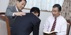 Older men giving Scriptural help to someone