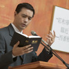 A Christian minister  delivering a Bible discourse