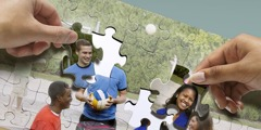 Two people working on a jigsaw puzzle