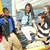 Teenagers sailing