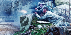 Camouflaged soldiers shooting guns in battle.