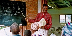 One of Jehovah's Witnesses teaching a literacy class to a group of people.