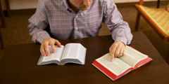 A man comparing two Bible translations