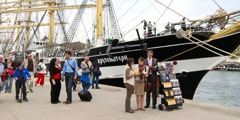 Jehovah's Witnesses offering Bible literature to people visiting the tall ships