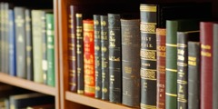 Various Bible translations on a bookshelf
