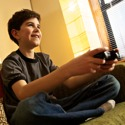 A young boy playing a video game