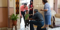 A couple bring their young son to visit his grandparents