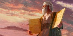 Moses holding the two stone tablets—the Ten Commandments