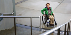 A teenage boy confined to a wheelchair