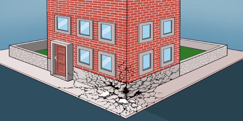 A brick building with a cracked foundation