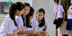 A group of schoolchildren in Thailand talking about the Awake! magazine