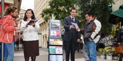 Jehovah's Witnesses use a literature-display cart to share the Bible's message with passersby