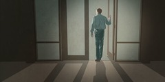 A man walks out of a Kingdom Hall