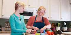 Emmaline and her mother work together in the kitchen
