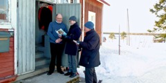 Two of Jehovah's Witnesses preach to a man in a remote northern area