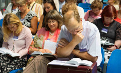 Convention attendees examine the newly released New World Translation in Estonian
