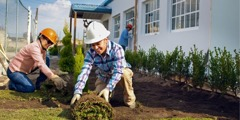Jehovah's Witnesses do landscaping outside a newly constructed Kingdom Hall