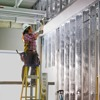 A worker checks the spacing between electrical conduits