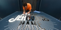 """Preparing the entry sign for """"A People for Jehovah's Name"""" exhibit"""