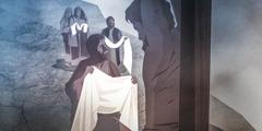 Preparing to wrap Jesus' body in linen cloths