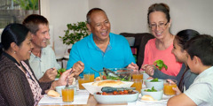 Renée Leron and his wife share a meal with friends