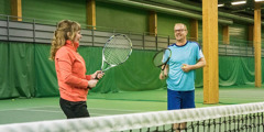 Veli Paloheimo gives a woman a tennis lesson