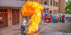 A firefighter demonstrates the danger of trying to extinguish burning oil with water