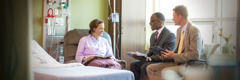 Two elders who serve on a Patient Visitation Group visit one of Jehovah's Witnesses in a hospital