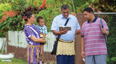 Solomone Tonga and his family teach the Bible to a man