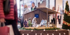 A scene depicting three wise men bringing gifts to baby Jesus