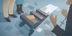 Besen duhovnik se spravi nad voziček za literaturo in razmeče publikacije, medtem ko mož in žena, ki sta Priči, mirno stojita zraven.