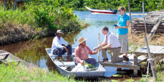 A couple who are need-greaters share the Bible's message with two men in a boat
