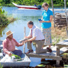 A couple who are need-greaters share the Bible's message with a man in a boat