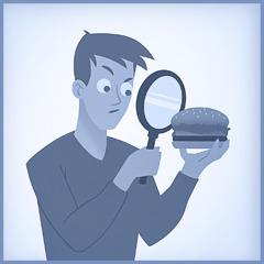 Um jovem examina sua comida de perto